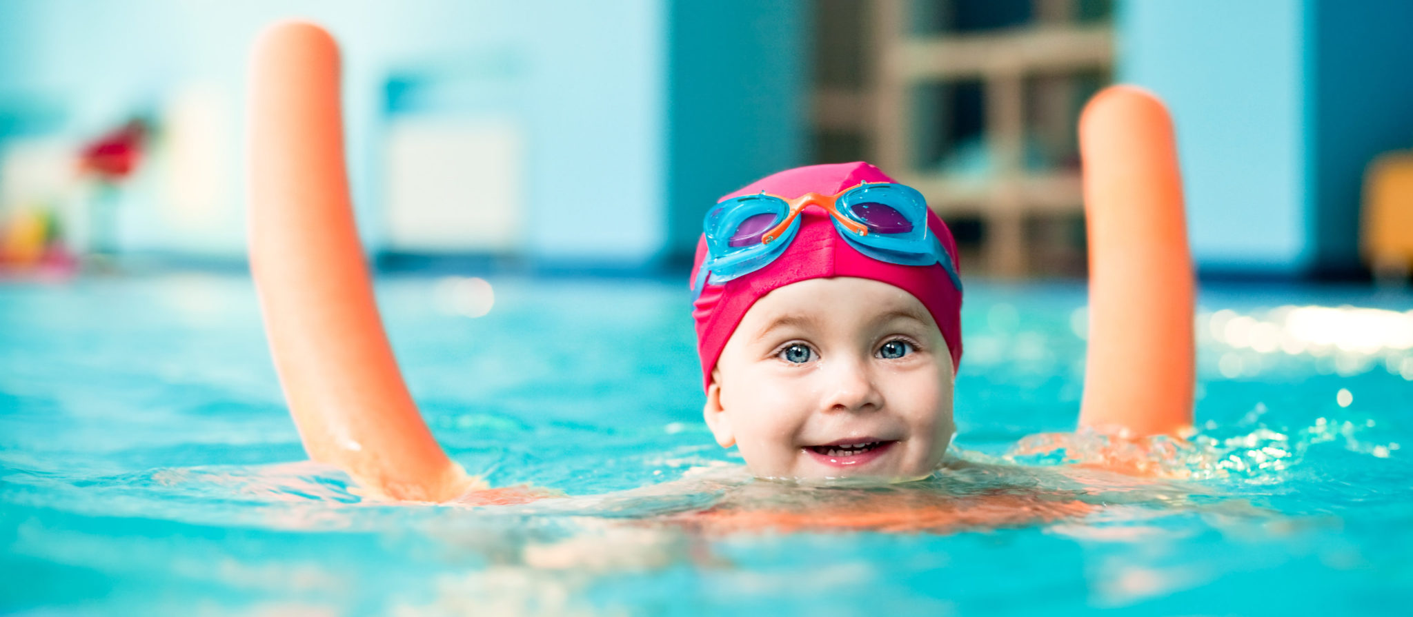 Children receive physical benefits and mental benefits from swimming and playing with pool toys.